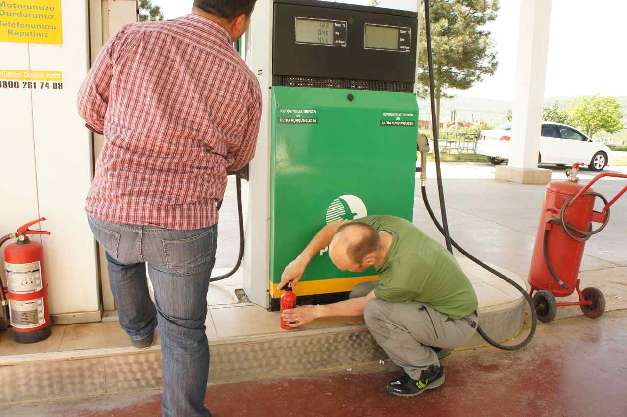 Buying 0.5 liters of petrol.