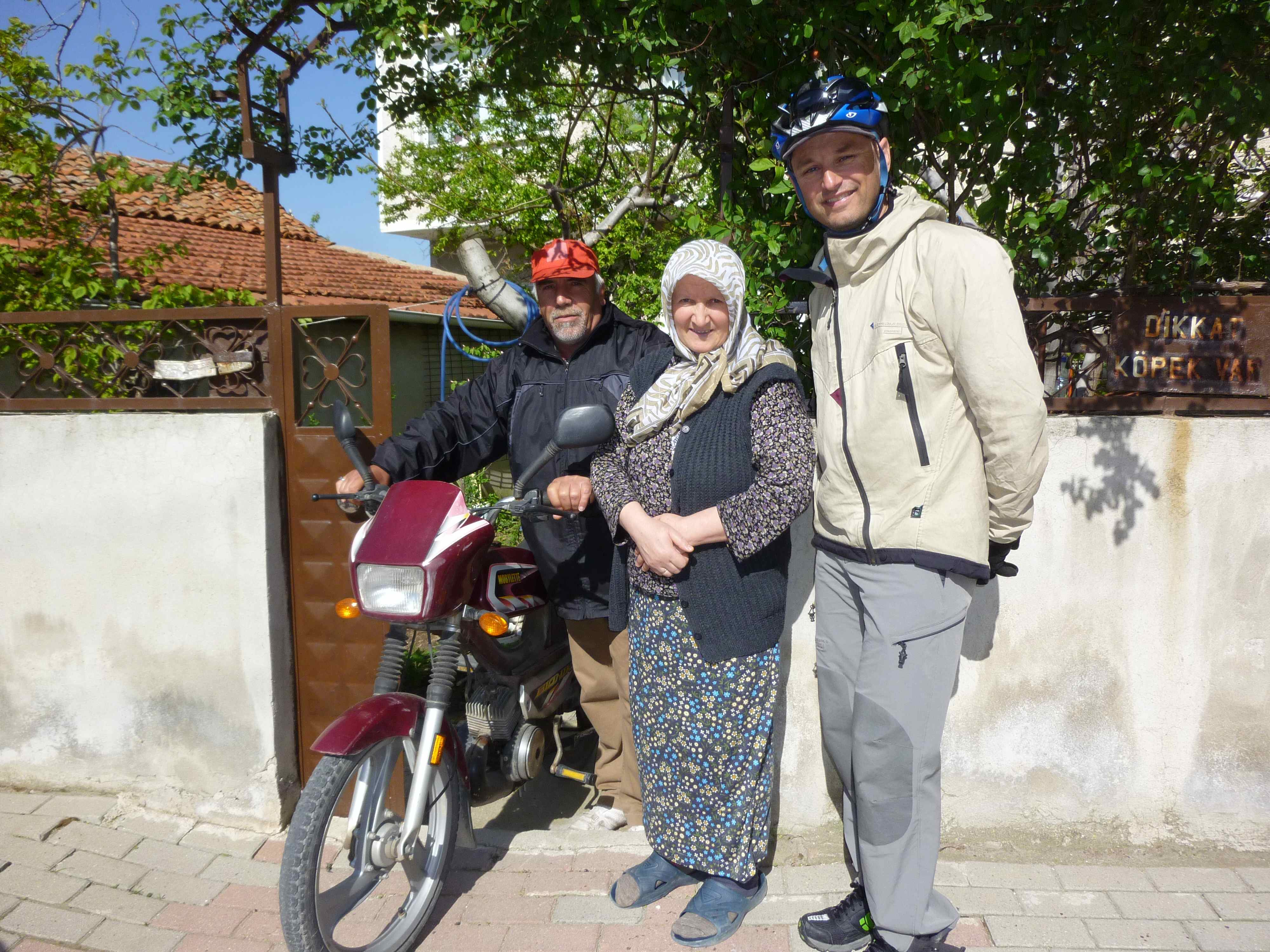 Selcuk's mom in the middle and dad ready to guide us out of town