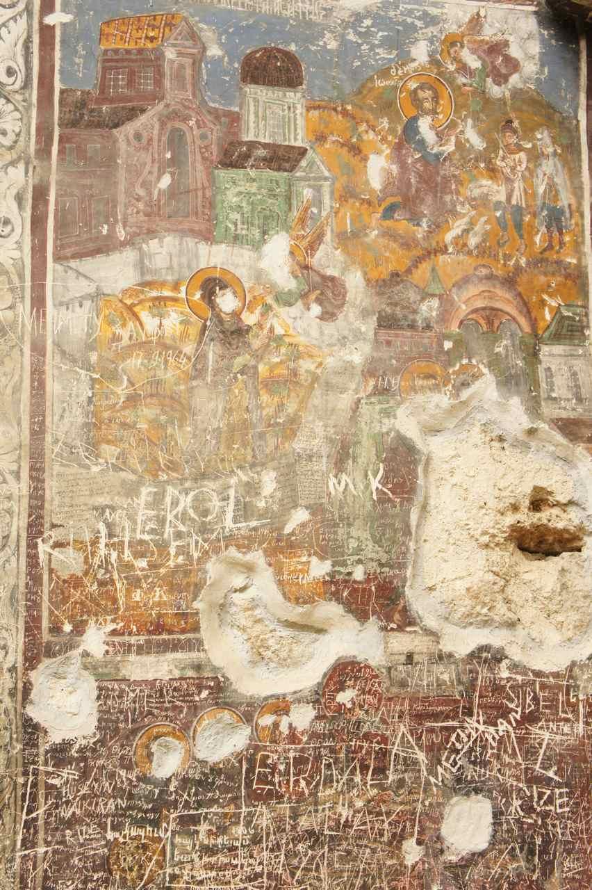 Tragic graffiti on old murals