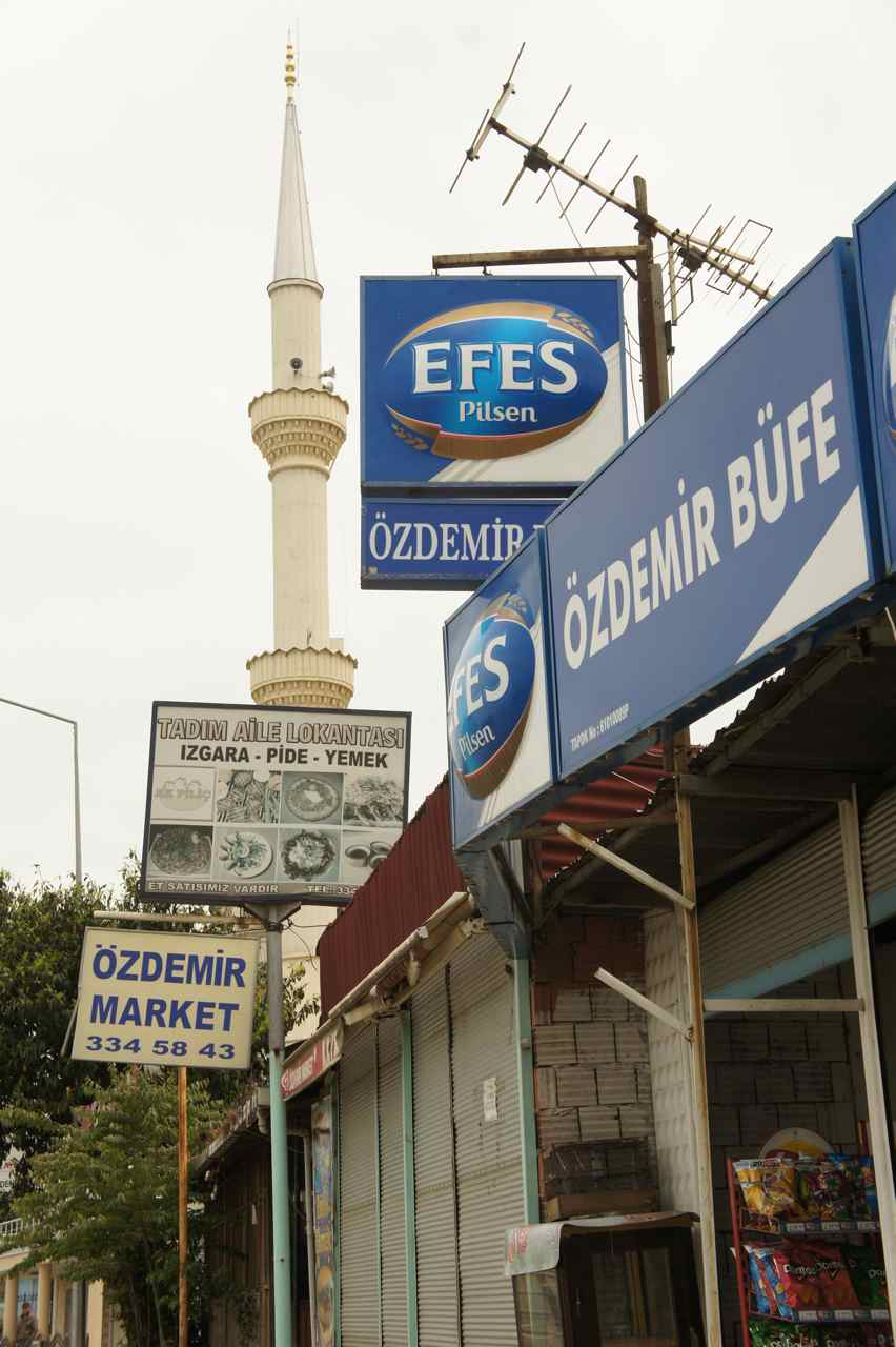 The variation that makes Turkey rich. A minaret and a beer shop side by side.