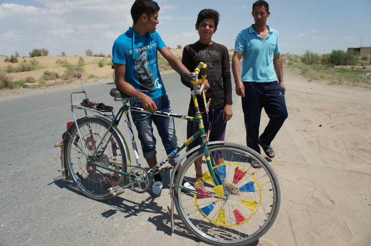 Boys with a nicely decorated bicycle