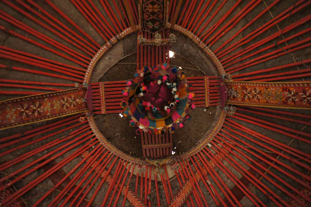 The colourful inside of the yurt's roof