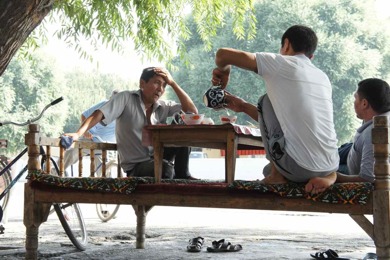 Some men having breakfast at a tea house
