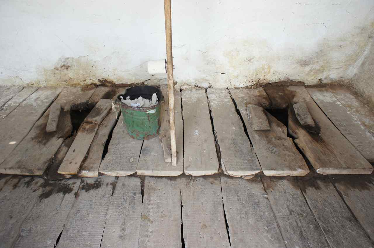 Scared of the dark when going to the loo?   Then bring a friend along.... This toilet is a standard toilet in central asia. We have seen better and far worse