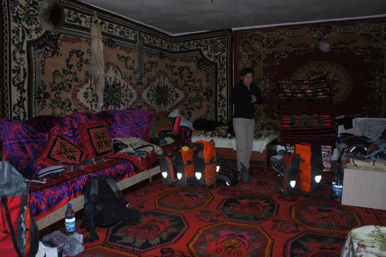 Interior of the first homestay with thick carpets on the walls