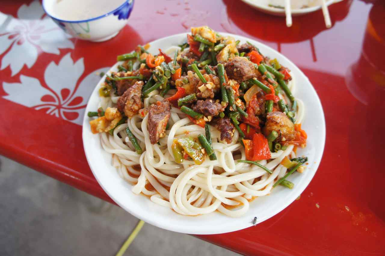 "Another plate of ""Lagman"" which is a central asian noodle dish that we are getting tired of. The noodles are handmade at the time of order, which takes some time. They taste wonderfully, but we could do with some other meat than mutton for a change. The roadside restaurants seem to only sell lagman or at least that is the only think we manage to order ;-)"