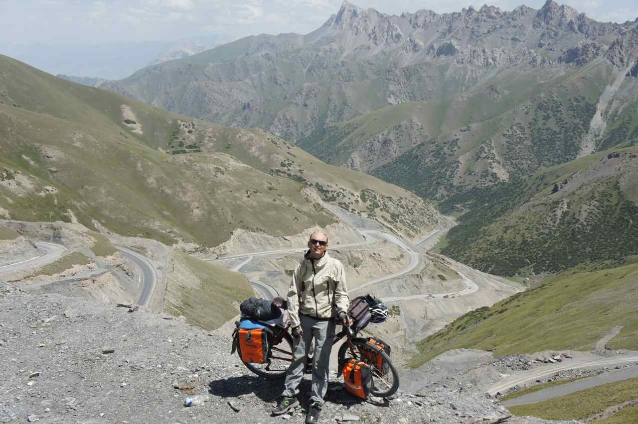 Happy after having climbed the switchbacks below. One day I'll come back and ride them in the opposite direction....