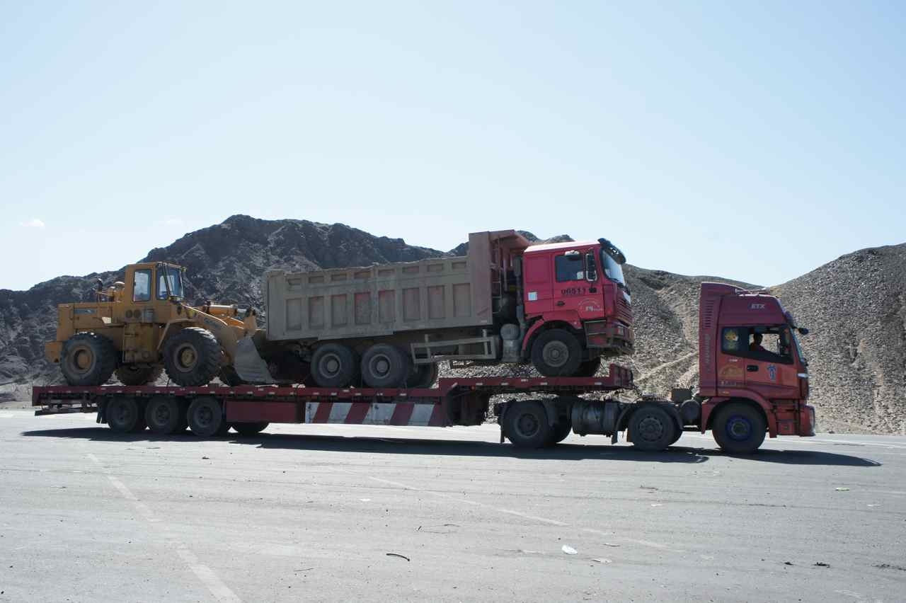 If two empty trucks are going the same way, then it's smarter if one carries the other... :-)