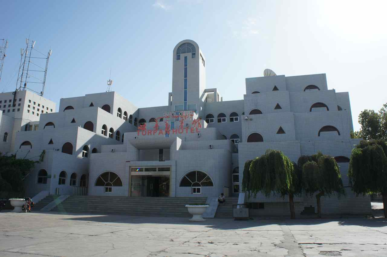 Hotel Turpan with its white tiled exterior