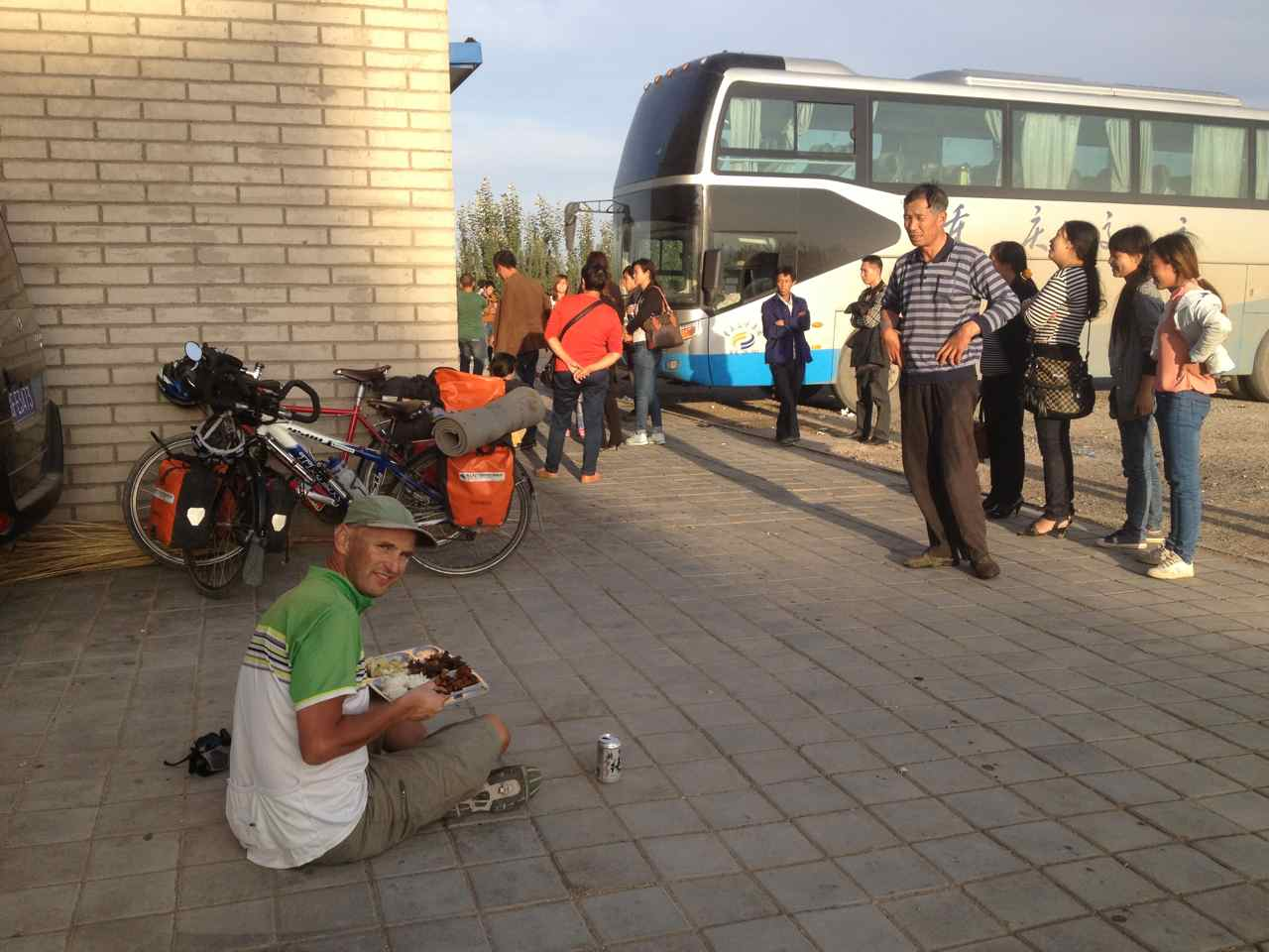We couldn't watch our bikes from inside the restaurant so we had to eat outside to the amusement of the many  passengers of the buses that made dinner stops there. The can in front of me is not a beggars bowl, but my reward after fighting a long day against a strong headwind.