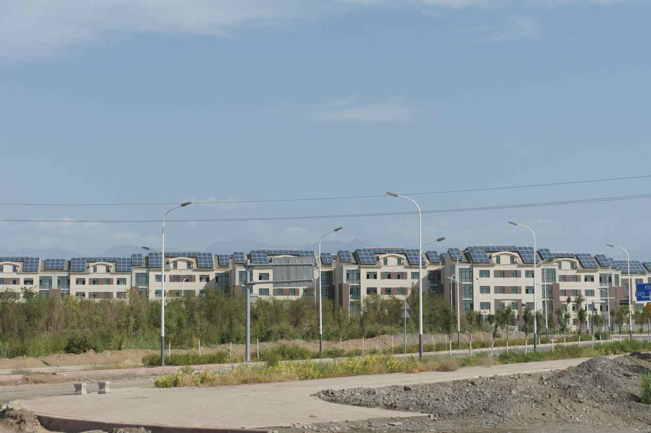 Newly constructed apartment blocks with electricity generating solar panels on the roofs