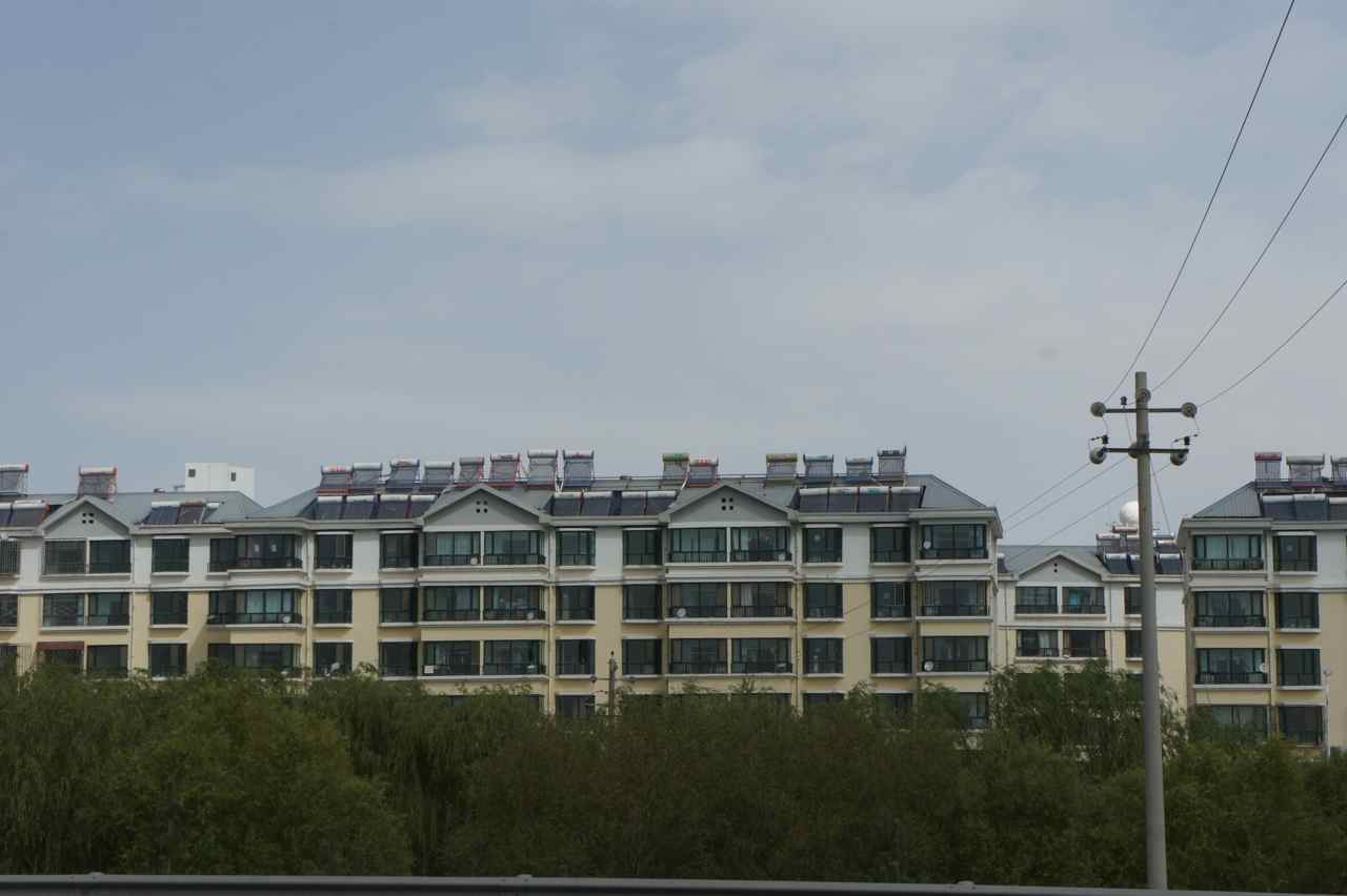 Modern buildings with solar thermal collectors on the roofs