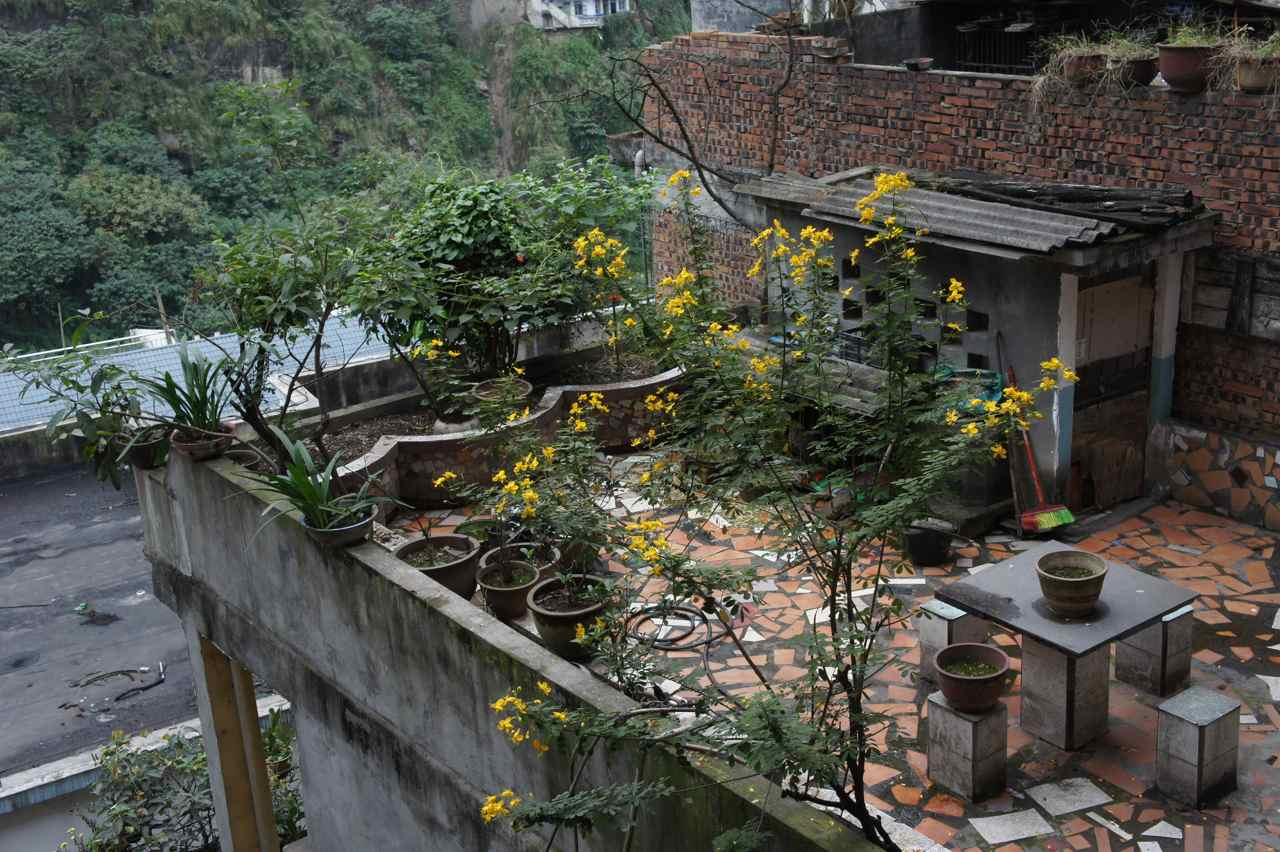 View from our hotel room over the neighbour's balcony in Yinjim. They even had a rooster who lived on that balcony