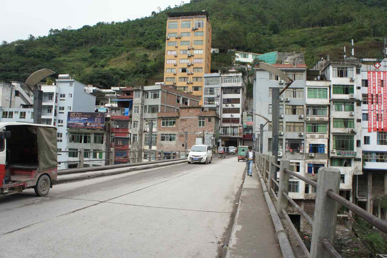 The hills are right behind the few line of buildings in the world's most narrow town.