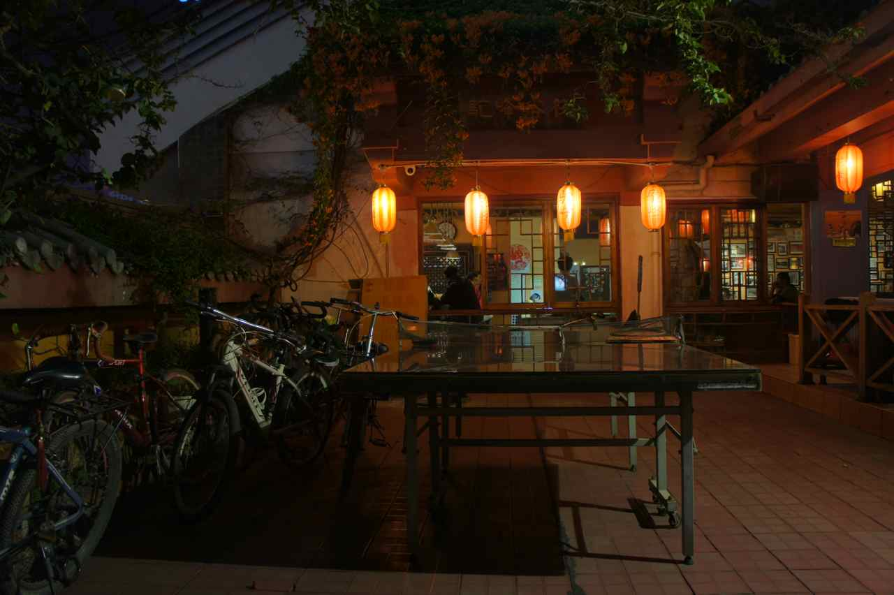 This photo shows the roof top bar at our guesthouse. Can it be more chinese with red lanterns, a ping-pong table and bicycles...