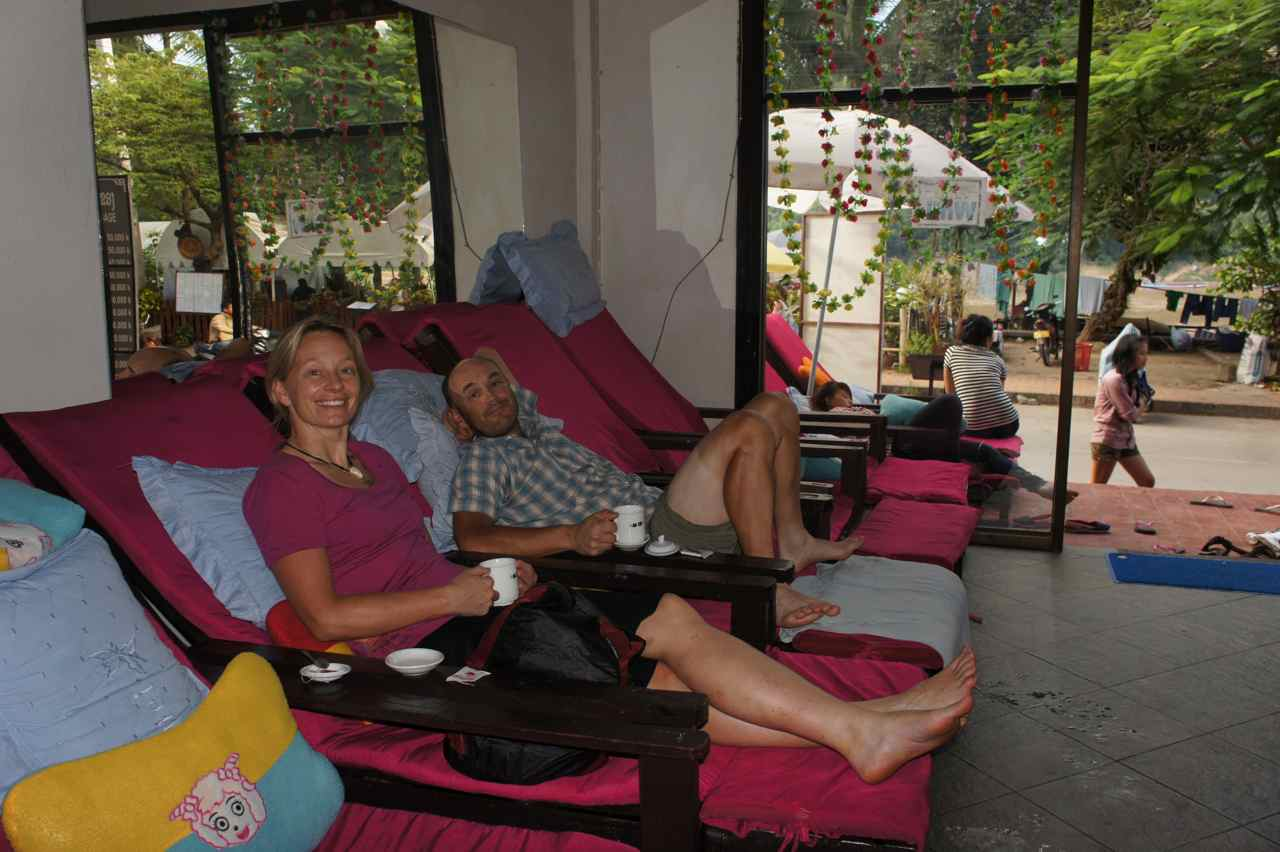 Waiting for a foot massage in Luang Prabang. The quick changes between the cosy life in nice guesthouses and rough camping is one of the joys of this journey. Look at my two colored legs -  I am working hard to get a true cyclist tan