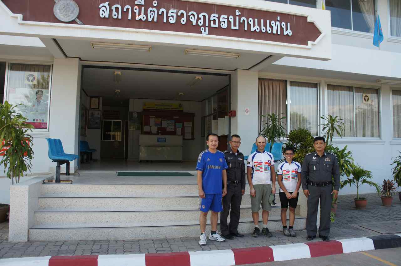 Posing outside the police station with the very welcoming police officers