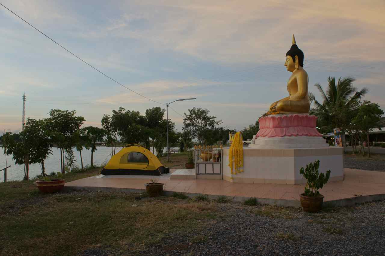 Camping in front of a Buddha statue