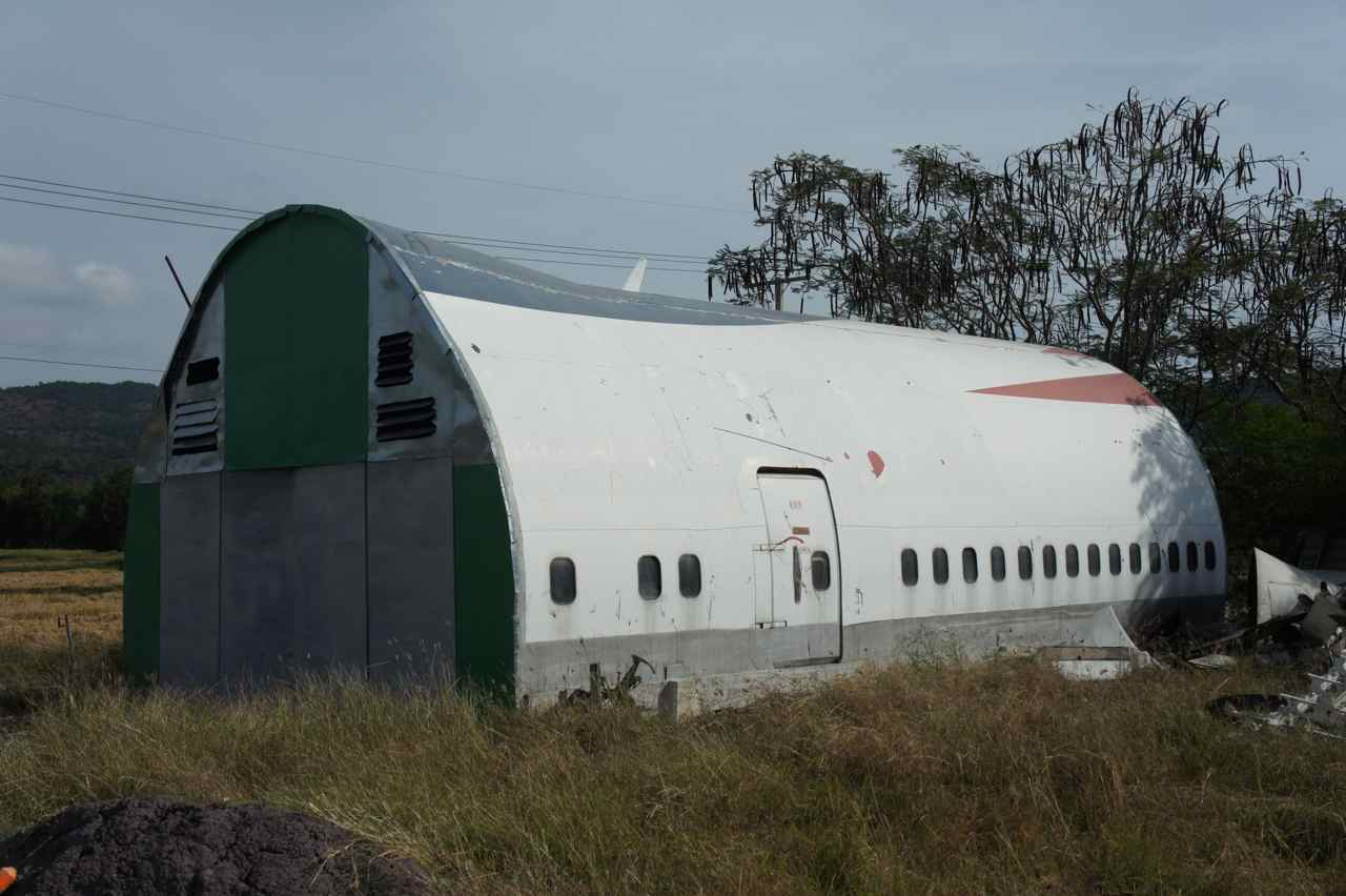 A B747 fuselage used as a store room. I'd like to get such a section to use as a summer house. Anyone who knows where to buy it - at the airport???