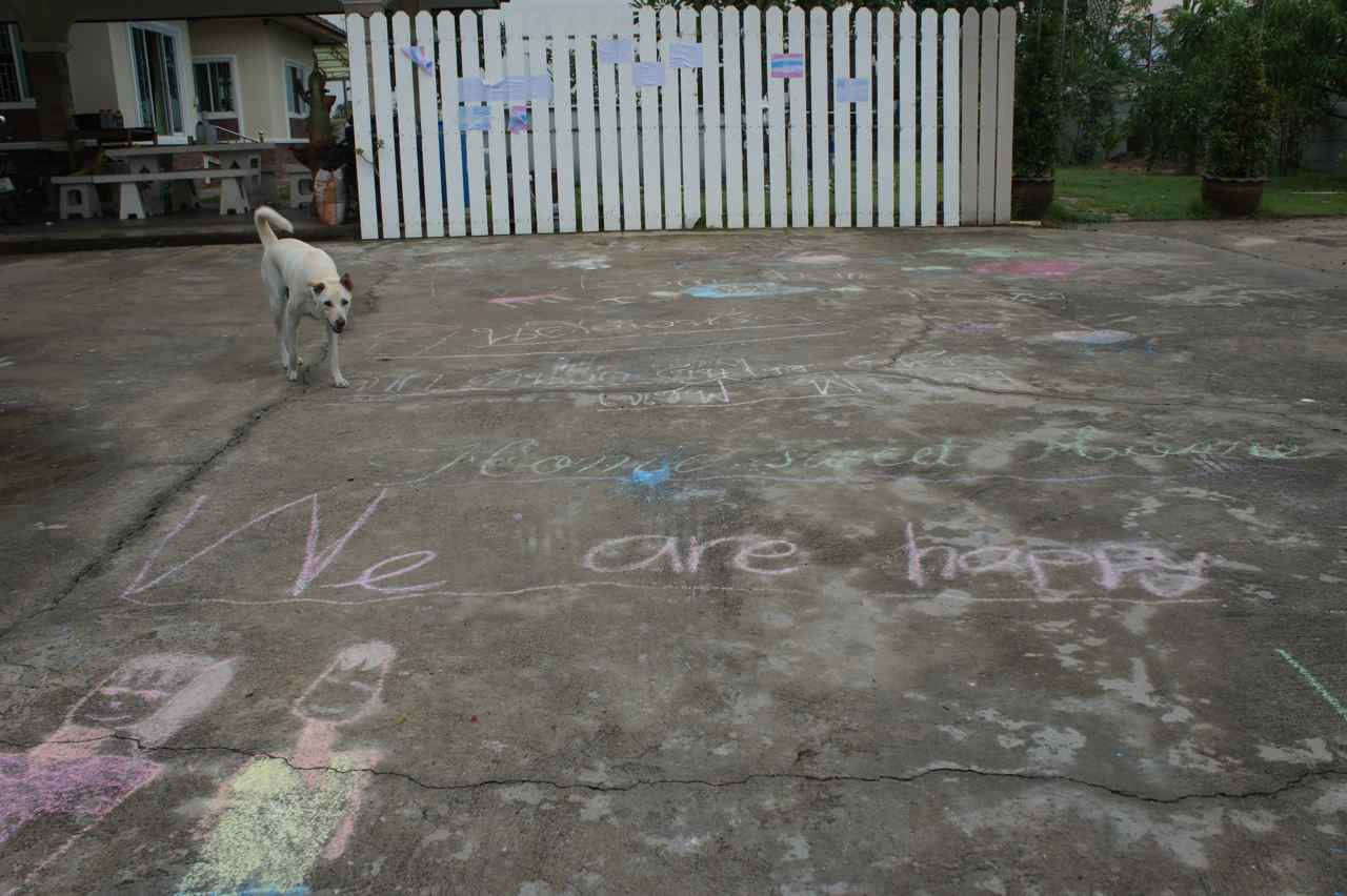 The ground painted with welcoming words