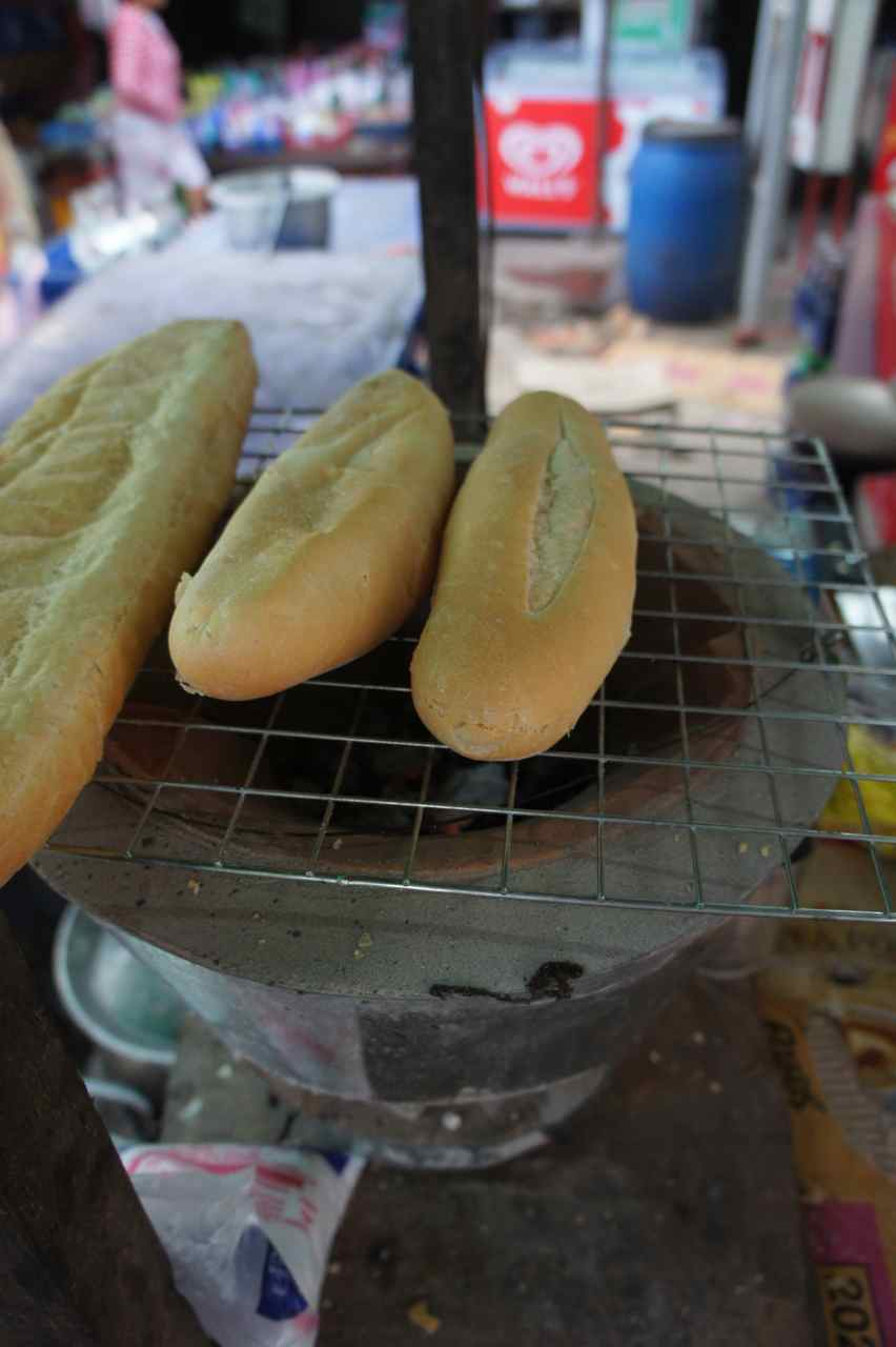 "Laotian-french ""khao jii"" baguettes on the grill"